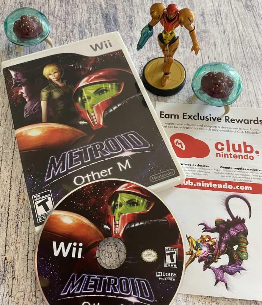 Metroid Other M case, disc, Club Nintendo insert, Samus amiibo and two Metroid figures