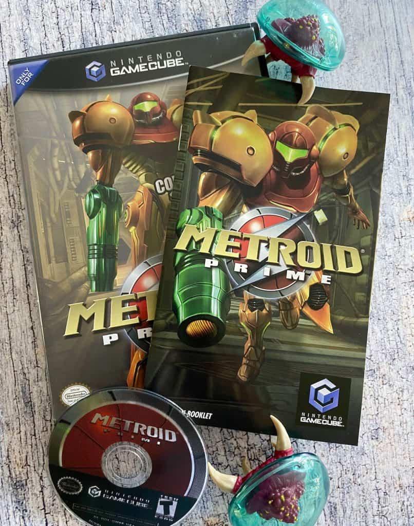 Metroid Prime case, manual, disc, and Metroid figure