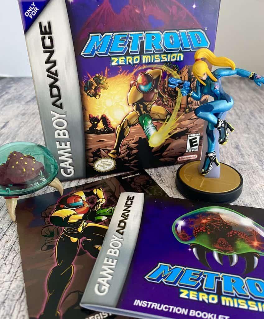 Metroid Zero Mission box, manual, insert and Zero Suit Samus amiibo with Metroid figure