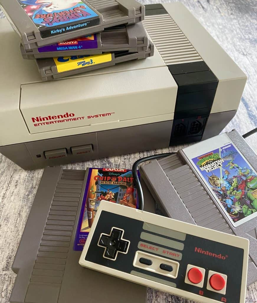 Original NES console with controller and several of my favorite games