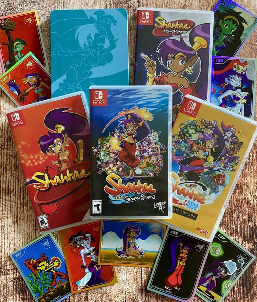 All five Shantae game cases for Switch, with Shantae Limited Run trading cards for Shantae and Risky's Revenge