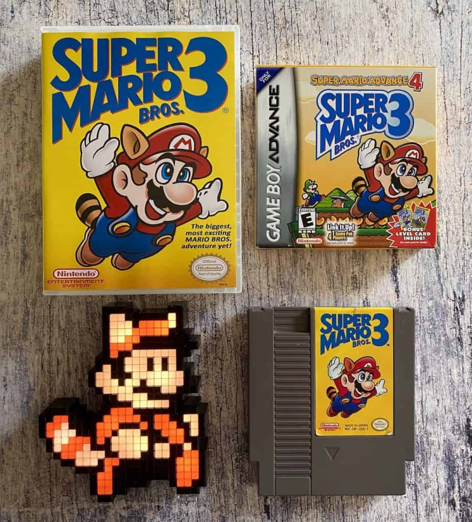 Super Mario Bros. 3 box, cart, Game Boy Advance version, and Racoon Mario pixel pal