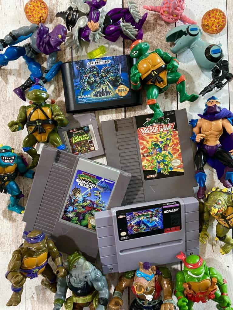 Turtles II NES cart, Turtles III NES cart, Hyperstone Heist Genesis cart, Turtles in Time SNES cart, and Fall of the Foot Clan GB cart all surrounded by early 90s Turtles action figures