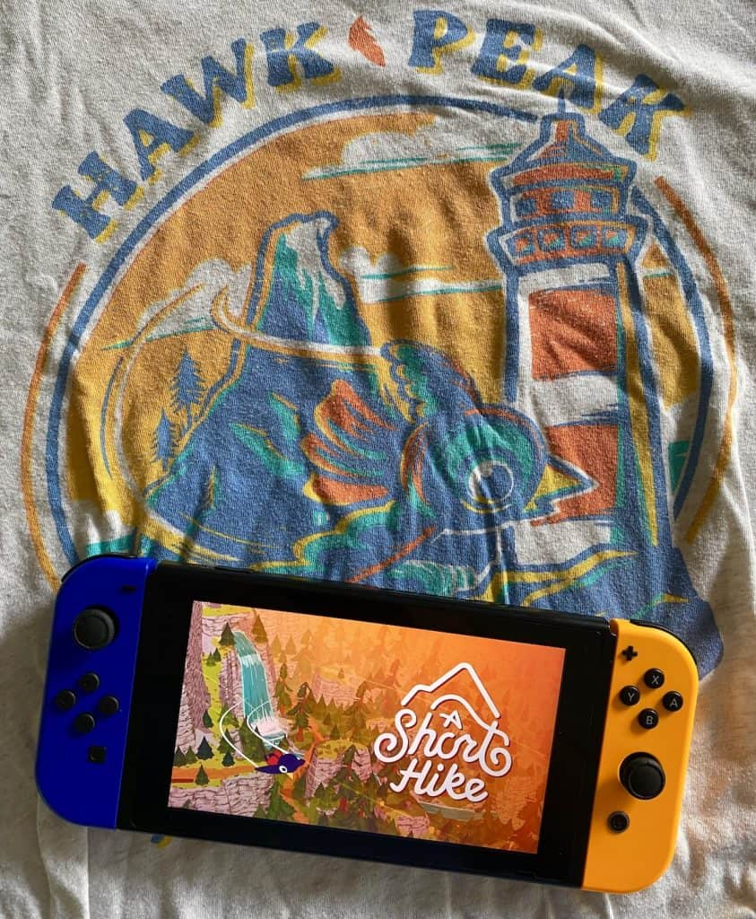 A Short Hike playing on Switch with shirt from Fangamer