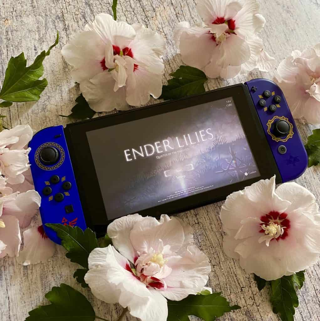 Ender Lilies: Quietus of the Knights on Switch surrounded by flowers