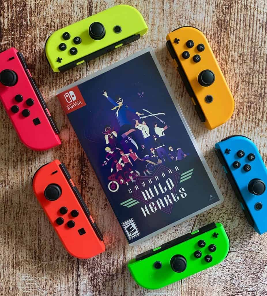 Sayonara Wild Hearts Switch physical copy surrounded by colorful joy cons
