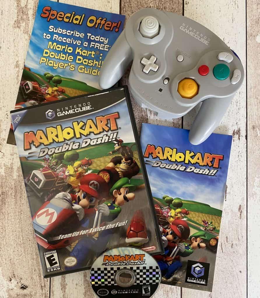 Mario Kart Double Dash!! case, manual, disc, Nintendo Power insert, and Wavebird controller